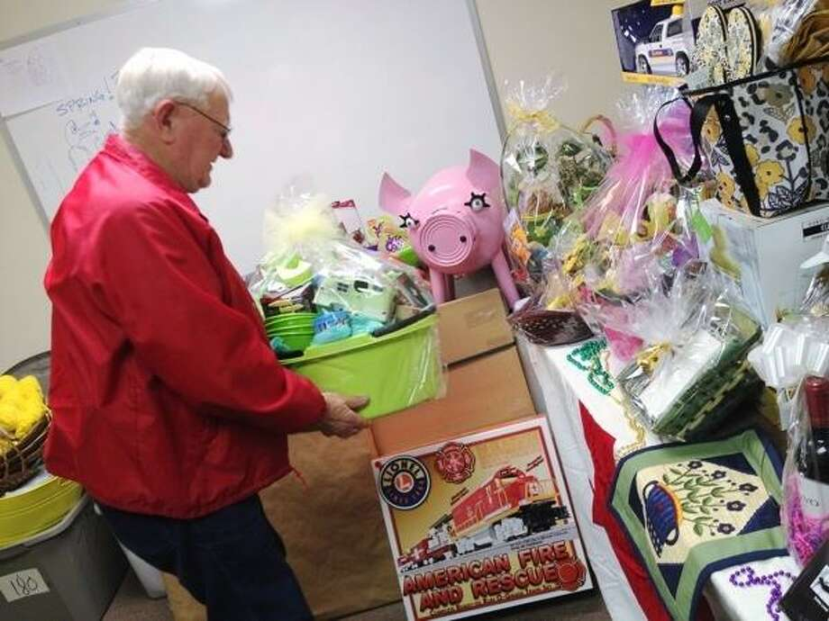 JOHN HAEGER @ONEIDAPHOTO ON TWITTER/ONEIDA DAILY DISPATCH Carl Carlstead of the American Red Cross sorts baskets for the upcoming silent auction on Friday, April 5, 2013.