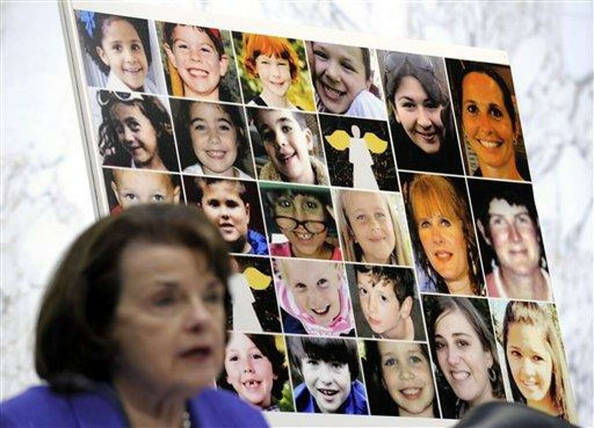 The faces of Sandy Hook Elementary School victims are seen behind Sen. Dianne Feinstein, D-Calif., as she speaks Feb. 27 about the Assault Weapons Ban of 2013 during the Senate Judiciary Committee on Capitol Hill in Washington. Congress returns Monday from a two-week spring recess with gun control and immigration high on the Senate's agenda. Senators could start debating Democratic-written gun legislation before week's end. But leaders also might decide to give negotiators more time to seek a deal on expanding background checks for firearms buyers. Associated Press file photo