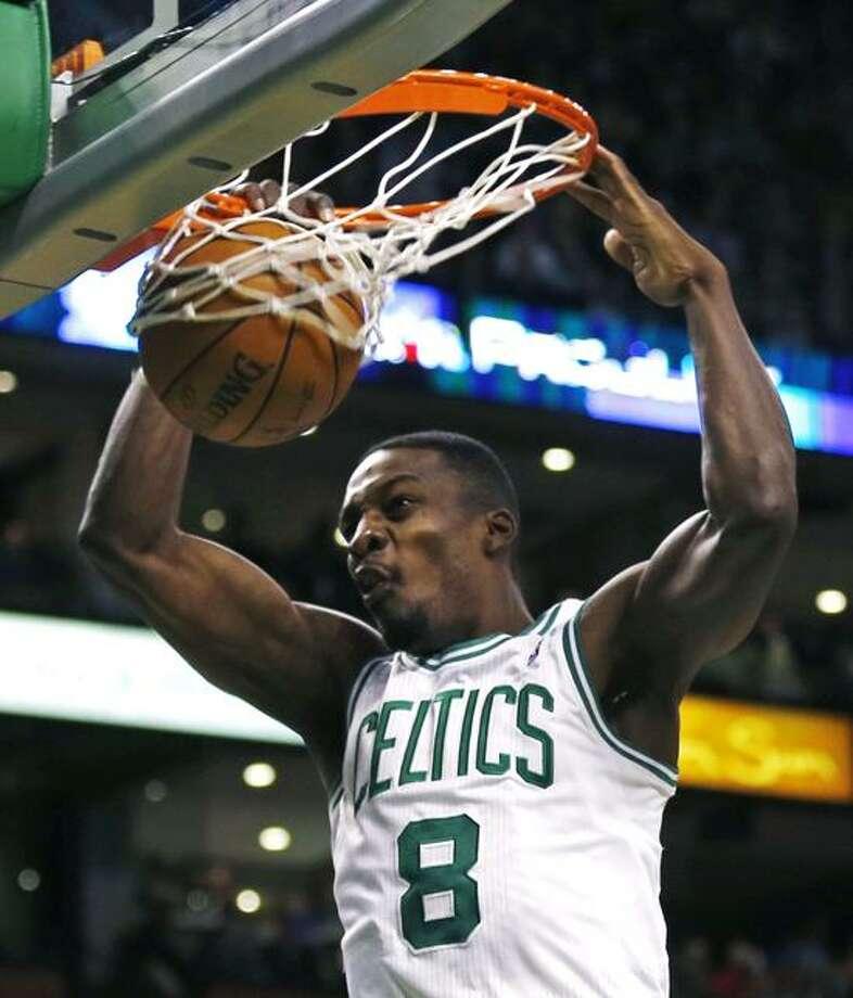 Boston Celtics forward Jeff Green (8) slams a dunk during the second quarter of an NBA basketball game against the Orlando Magic in Boston, Friday, Feb. 1, 2013. (AP Photo/Charles Krupa) Photo: AP / AP2013