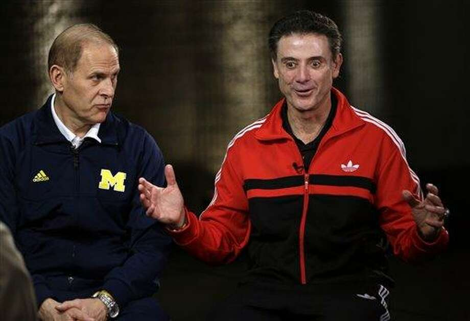 Louisville head coach Rick Pitino and Michigan head coach John Beilein, left, participate in a television interview for their NCAA Final Four tournament college basketball game Sunday, April 7, 2013, in Atlanta. Louisville plays Michigan in the championship game on Monday. (AP Photo/David J. Phillip) Photo: ASSOCIATED PRESS / AP2013