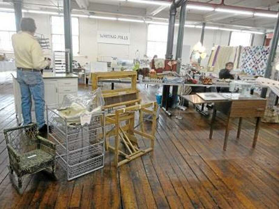 Jason Siedzik / Register Citizen -- Six of the artists at Whiting Mills held an indoor tag sale, offering up an eclectic mix of merchandise, props and personal belongings.