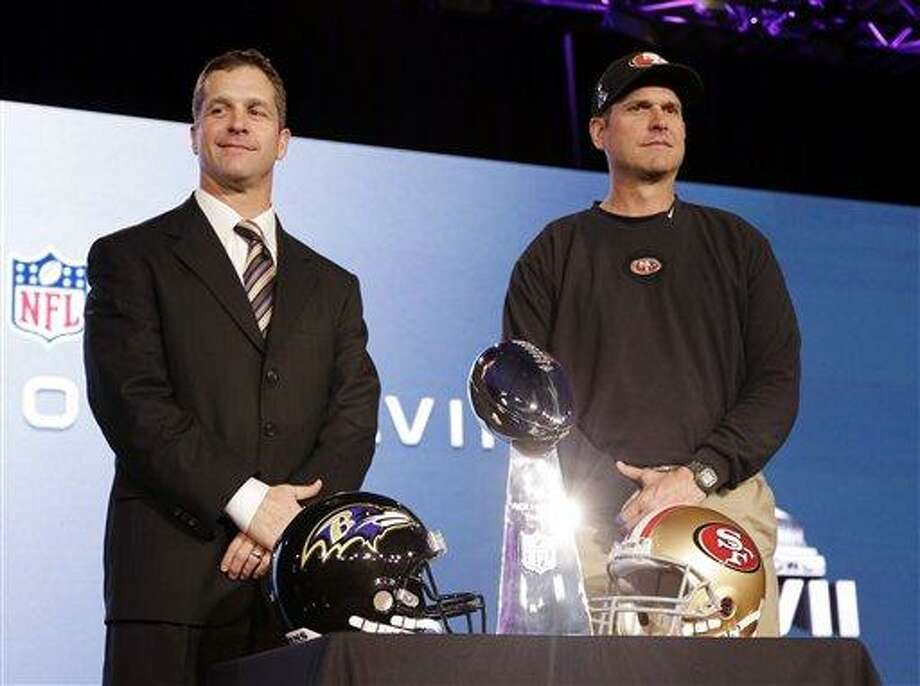 San Francisco 49ers head coach Jim Harbaugh and Baltimore Ravens head coach John Harbaugh participate in a news conference for the NFL Super Bowl XLVII football game Friday, Feb. 1, 2013, in New Orleans. (AP Photo/Mark Humphrey) Photo: ASSOCIATED PRESS / AP2013