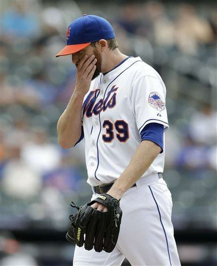 New York Mets relief pitcher Bobby Parnell (39) reacts leaving the mound after Mets manager Terry Collins removed Parnell from the game in the tenth-inning of the Mets 8-4 loss to the Miami Marlins in a baseball game in New York, Sunday, June 9, 2013.  Parnell allowed two hits to the Marlins and Adeiny Hechavarria reached on Daniel Murphy's fielding error allowing Logan Morrison to score the go-ahead run. (AP Photo/Kathy Willens) Photo: AP / AP