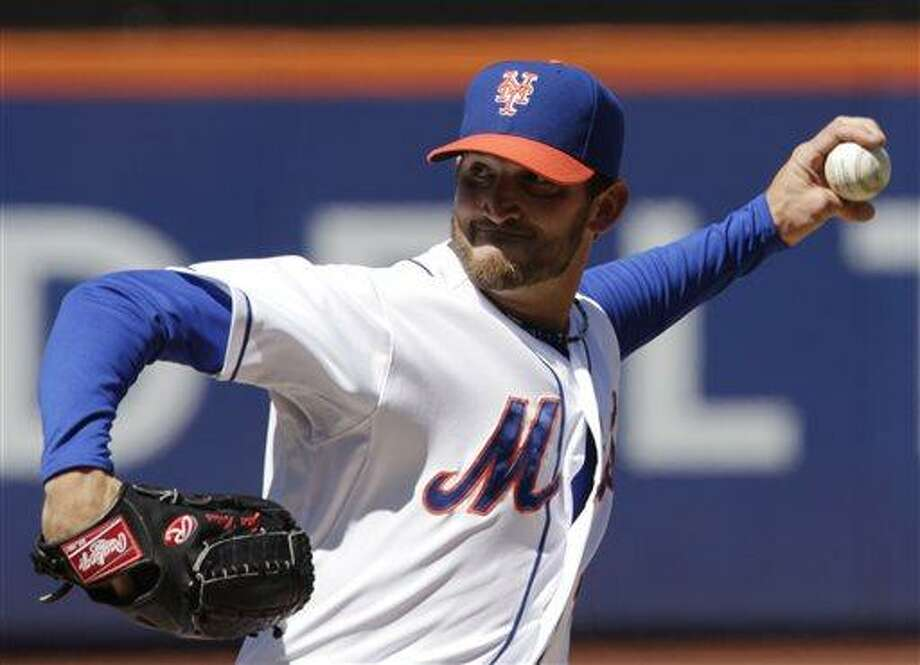 New York Mets starting pitcher Jonathon Niese throws in the first inning of a baseball game against the Miami Marlins at Citi Field, Saturday, April 6, 2013 in New York. (AP Photo/Mark Lennihan) Photo: AP / AP