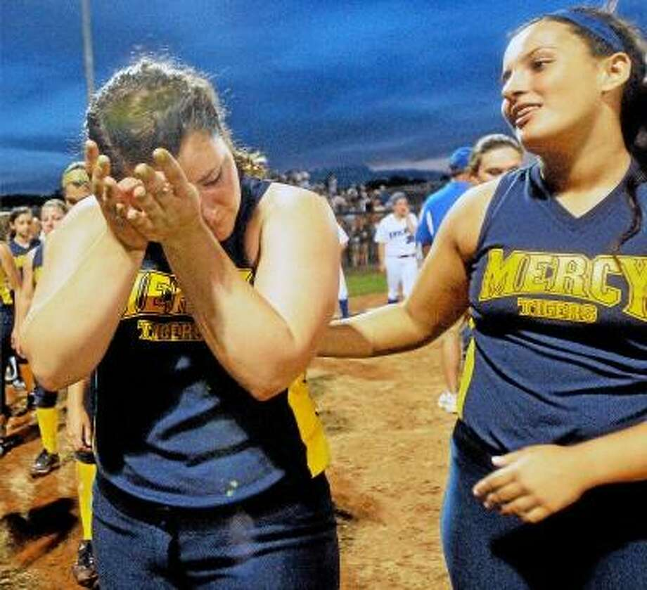 Catherine Avalone/The Middletown Press Mercy senior captain and catcher Tyler Keegan is consoled by junior Abigayle LaRosa following their 1-0 loss to Southington at Frank Biondi Softball Field at West Haven High School Sunday night in the Class LL State Championship game. / TheMiddletownPress