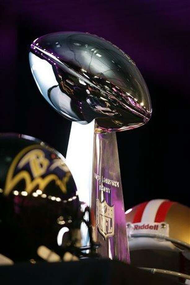 AP Photo The Vince Lombardi trophy is displayed before and San Francisco 49ers head coach Jim Harbaugh and Baltimore Ravens head coach John Harbaugh participate in a news conference on Friday, Feb. 1, 2013, in New Orleans for Super Bowl XLVII. Photo: AP / AP