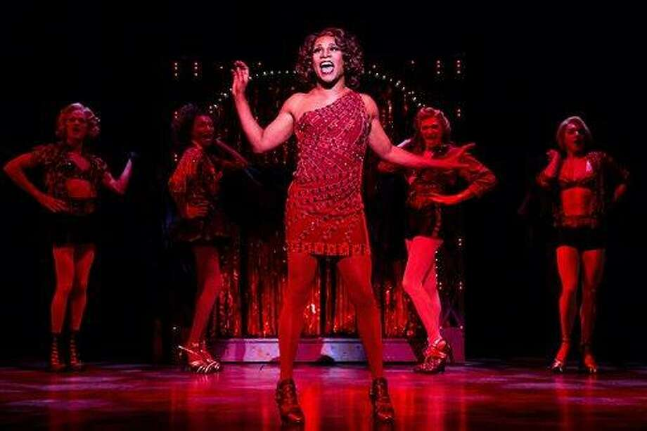 "This theater image released by The O+M Company shows Billy Porter during a performance of ""Kinky Boots."" The Cyndi Lauper-scored ""Kinky Boots,"" based on the 2005 British movie about a real-life shoe factory that struggles until it finds new life in fetish footwear, is nominated for 13 Tony Award nominations.  The awards will be broadcast on CBS from Radio City Music Hall on June 9. (AP Photo/The O+M Company, Matthew Murphy) Photo: AP / The O+M Company"