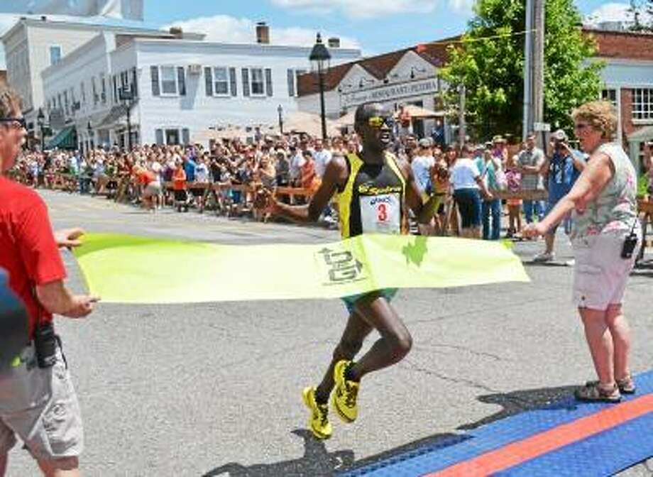 Eliud Ngetich, 19, of Kenya, won the 2013 Litchfield Hills Road Race on Sunday with a time of 33:55. John Berry/Register Citizen
