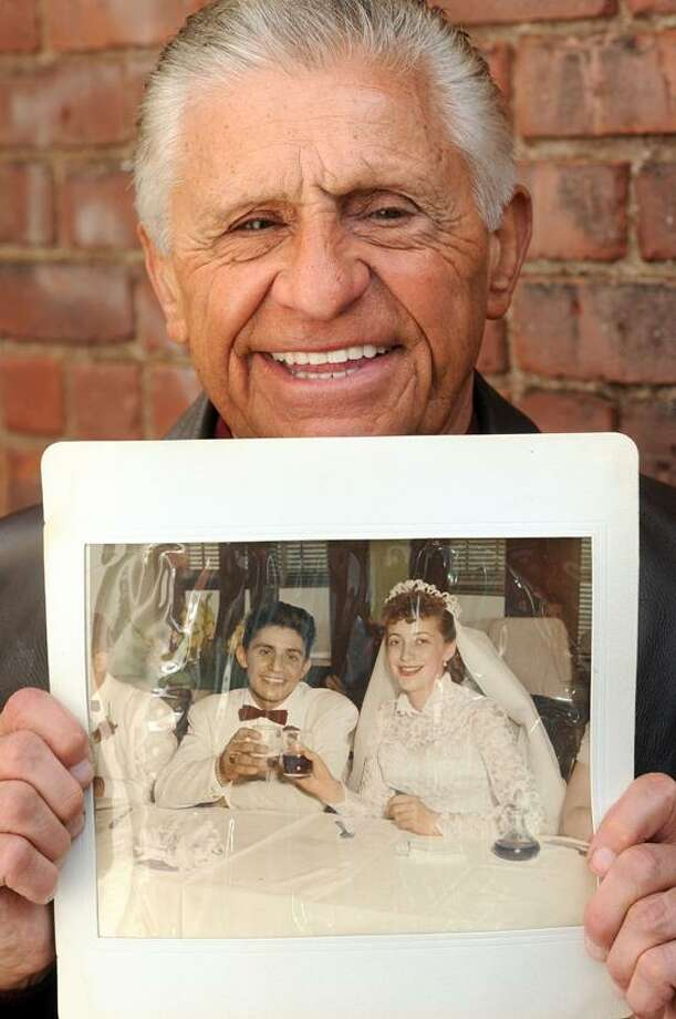 Charles Sommo Jr. of Northford holds his wedding photo with his wife Marie. Mara Lavitt/New Haven Register