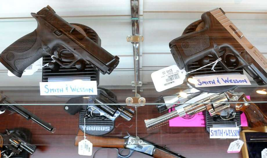 At the TGS Outdoors shop in Branford. The guns on the top shelf take large-capacity magazines that were banned Wednesday when Gov. Dannel P. Malloy signed a sweeping gun-control bill into law. Mara Lavitt/New Haven Register