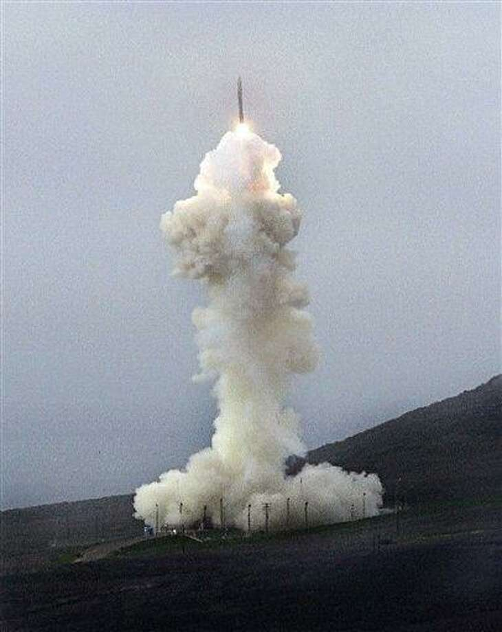 FILE - In this Saturday, Jan. 26, 2013 file photo, a ground-based interceptor launches from Vandenberg Air Force Base near Lompoc, Calif. The Obama administration will add 14 interceptors to the U.S.'s West Coast-based missile defense system, reflecting concern about North Korea's focus on developing nuclear weapons and its advances in long-range missile technology, officials said Friday, March 15, 2013. (AP Photo/The Santa Maria Times, Daniel Dreifuss, File) Photo: AP / The Santa Maria Times