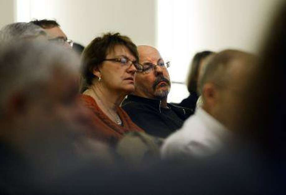Tom, right, and Terry Sullivan, who's son was killed in the Aurora theater shooting, attend a gun forum at The Denver Post, Tuesday April 2, 2013, in Denver. (AP Photo/The Denver Post, R.J. Sangosti ) MAGS OUT; TV OUT; INTERNET OUT; NO SALES Photo: AP / THE DENVER POST