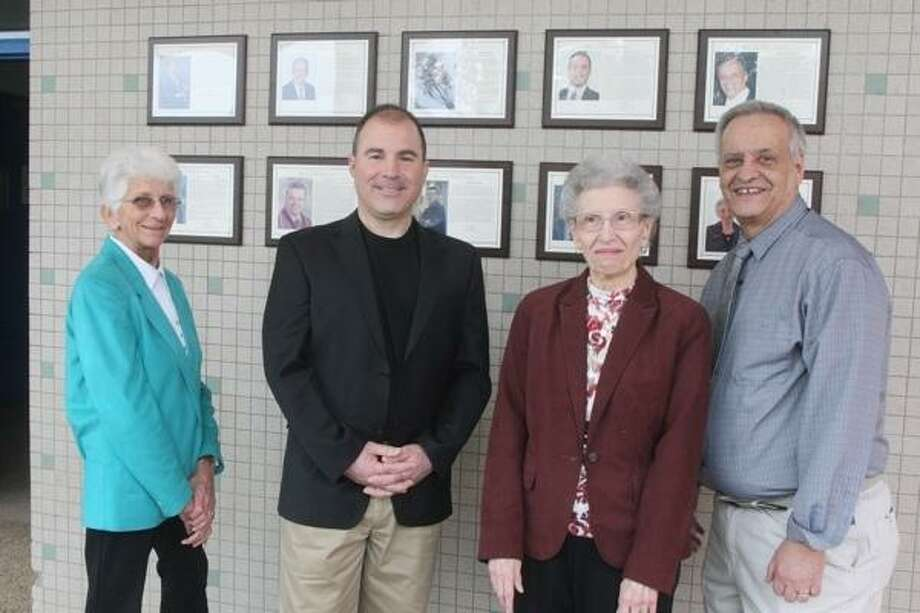 """JOHN HAEGER @ONEIDAPHOTO ON TWITTER/ONEIDA DAILY DISPATCH  Representatives of the 2012 Oneida CSD Foundation Wall of Distinction induction class Margaret """"Peg"""" Brown, Henry """"Hank"""" Leo, Virginia Seminaroti, and Mike Romano pose infront of their plaques at  Oneida High School on Friday April 5, 2013."""
