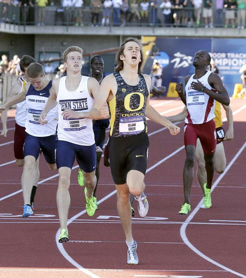 Oregon's Elijah Greer wins the men's 800 meters during the NCAA outdoor track and field championships in Eugene, Ore., Friday, June 7, 2013. Penn State runner Cas Loxsom, a Wilbur Cross graduate, finished second. (AP Photo/Don Ryan) Photo: AP / AP