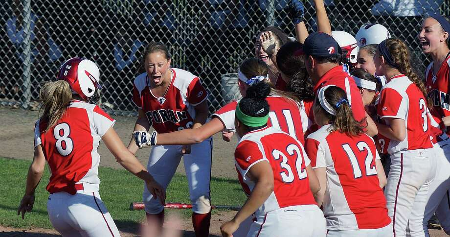 """Foran's Danielle Kemp crosses the plate after hitting a three-run homer during the sixth inning against Maloney in the Class L state softball semifinal. Foran faces Masuk in the Class L final Monday.  Photo-Peter Casolino/Register  <a href=""""mailto:pcasolino@newhavenregister.com"""">pcasolino@newhavenregister.com</a>"""