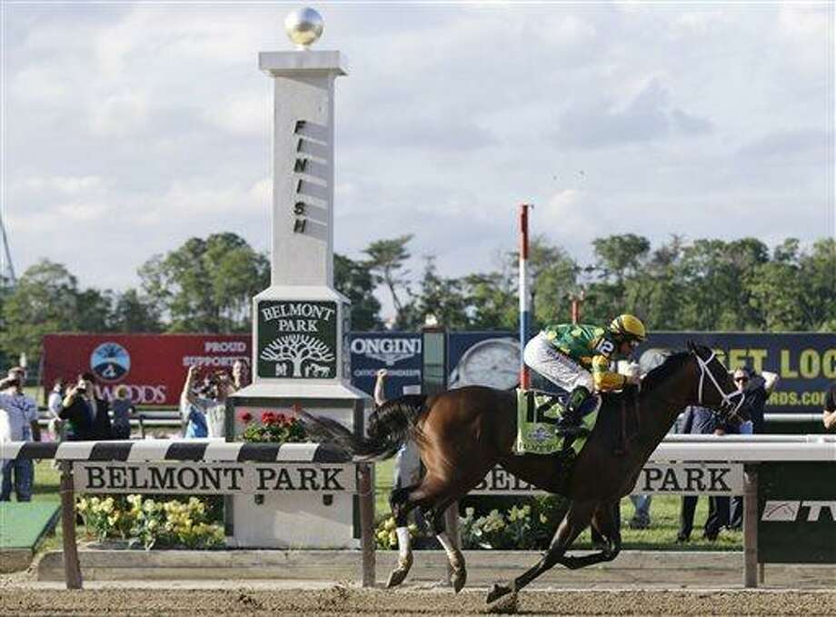 Palace Malice, ridden by jockey Mike Smith, crosses the finish line to win the the 145th Belmont Stakes horse race at Belmont Park Saturday, June 8, 2013, in Elmont, N.Y. (AP Photo/Frank Franklin II) Photo: AP / AP
