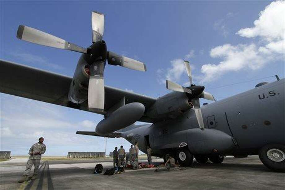 In this Feb. 7, 2013 file photo, members of the 374th Airlift Wing of U.S. Air Force work on a C-130 aircraft during the Cope North military exercises at Andersen U.S. Air Force Base in Guam. There soon will be another military element to life on the U.S. territory  _ a defense system will be installed to shoot down incoming missiles and warheads. Its deployment comes amid intensifying threats from North Korea, which recently listed Guam among its targets for a nuclear attack on the United States. (AP Photo/Koji Ueda, File) Photo: AP / AP