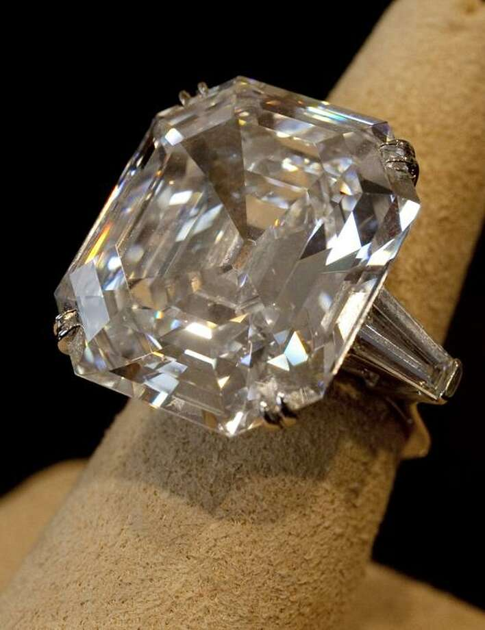 """FILE - This Sept. 1, 2011 file photo shows """"The Elizabeth Taylor Diamond,"""" a 33.19 carat a gift to the actress from Richard Burton at Christie's, in New York. The 33.19-carat diamond ring given to Elizabeth Taylor by actor Richard Burton sold for over $8.8 million at auction in New York Tuesday, Dec. 13, 2011. The ring was purchased in 1968 for $305,000. But diamond experts caution that the average diamond ring bought for a few thousand dollars by a consumer, while it will never be worthless, will not appreciate much if at all in value. (AP Photo/Richard Drew, File) Photo: AP / AP"""