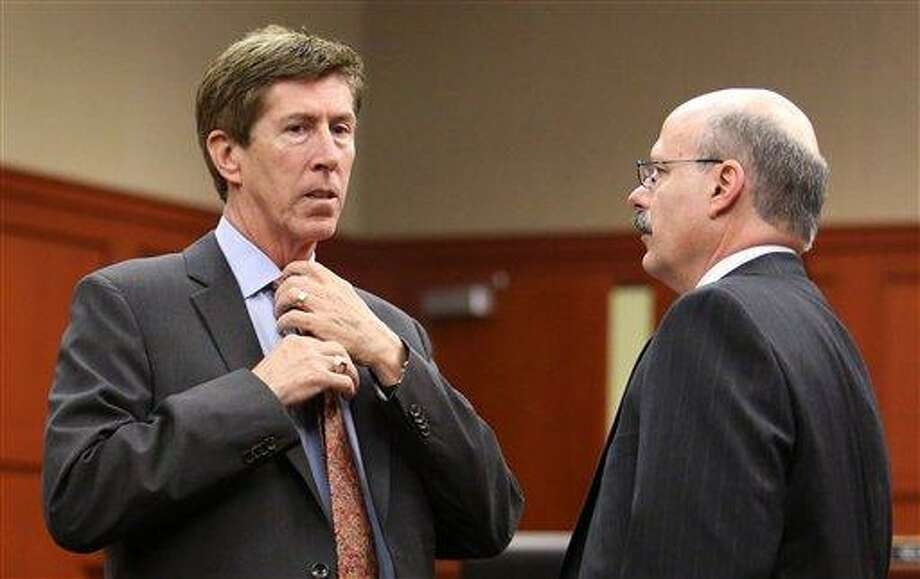 Defense counsel Mark O'Mara (left) has a discussion with Assistant State Attorney Bernie de la Rionda, before the start of the hearing, as attorneys for the state and George Zimmerman argue whether the attorney for Trayvon Martin's parents, Benjamin Crump, should be required to give a deposition for the defense, during a hearing in Seminole circuit court, in Sanford, Fla. Friday, Feb. 22, 2013.   Circuit Judge Debra S. Nelson said Attorney Benjamin Crump did not have information relevant to the case and it would violate laws protecting attorney-client privilege and attorney work product if he were forced to give a deposition to the defense. (AP Photo/Orlando Sentinel, Joe Burbank, Pool) Photo: AP / Pool, Orlando Sentinel