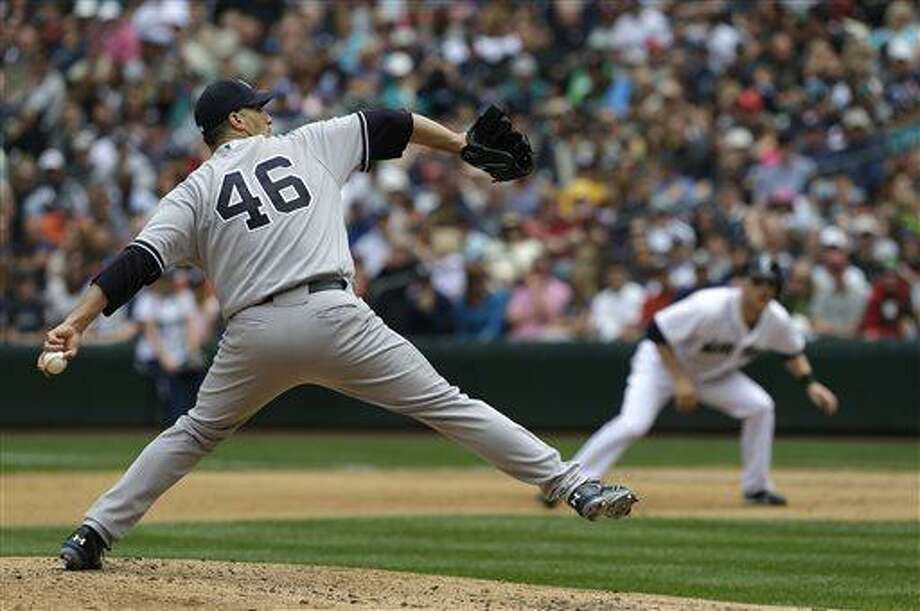 New York Yankees starting pitcher Andy Pettitte (46) throws in the fourth inning of a baseball game against the Seattle Mariners, Saturday, June 8, 2013, in Seattle. (AP Photo/Ted S. Warren) Photo: AP / AP