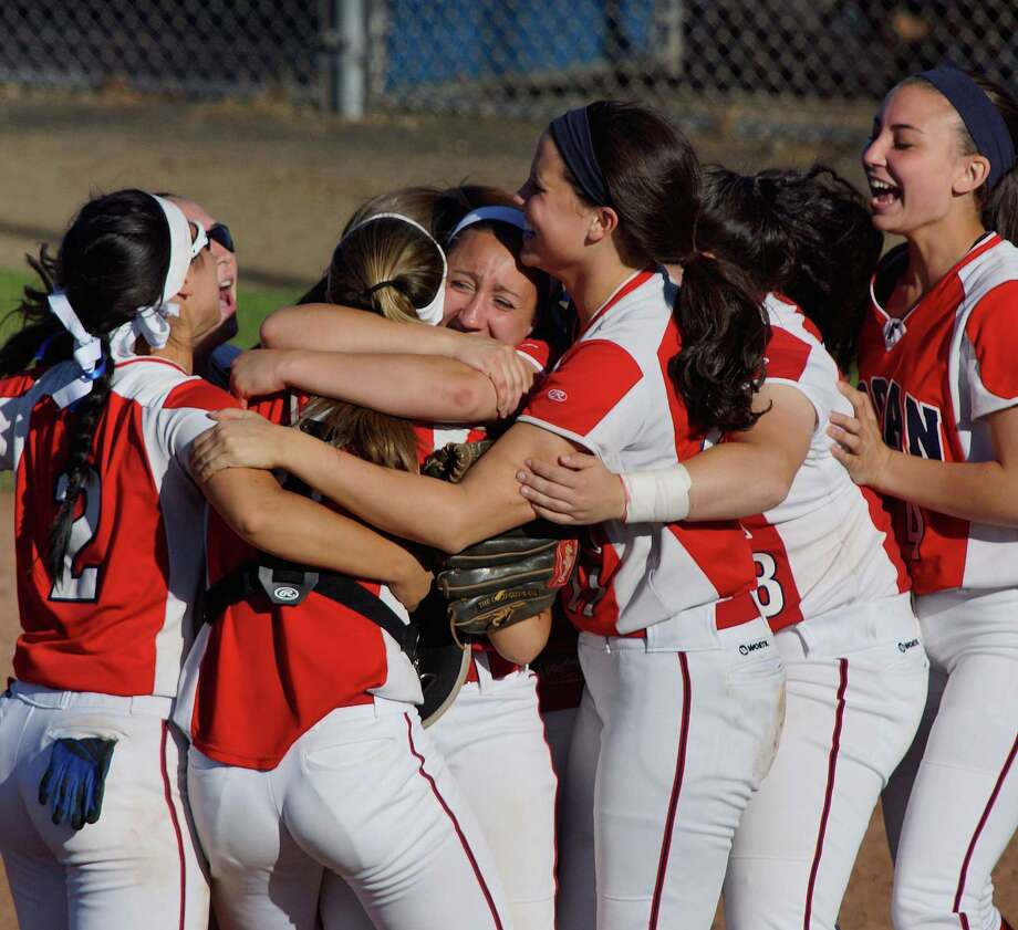 "Foran pitcher Jessica Harkness, center, celebrates with her teammates after Foran beat Maloney 5-4 for the Class L state softball semifinal.   Photo-Peter Casolino/Register  <a href=""mailto:pcasolino@newhavenregister.com"">pcasolino@newhavenregister.com</a>"
