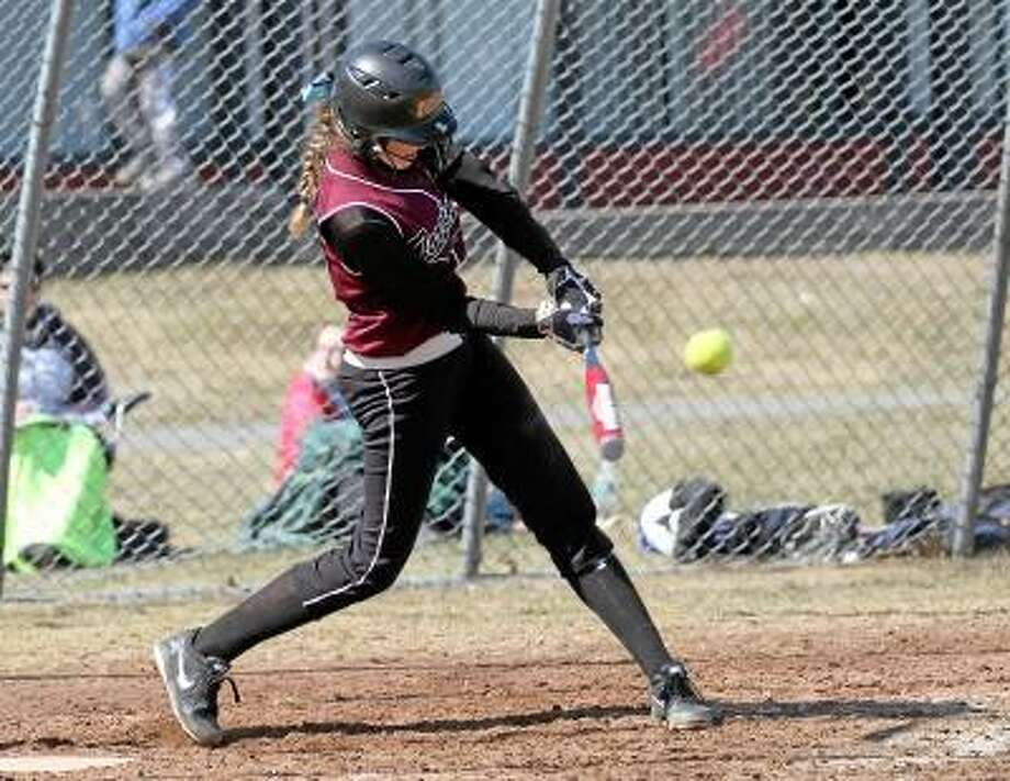 Torrington Pitcher Sydney Matzko connects for a single in her team's win over Lewis Mills Saturday morning. Photo by Marianne Killackey/Special to Register Citizen / 2013