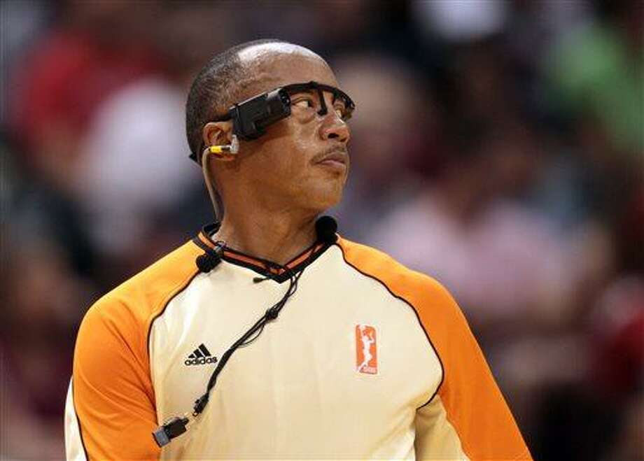 Official Lamont Simpson wears the WNBA's new camera during the Phoenix Mercury against the Indiana Fever basketball game that was nationally televised from Indianapolis, Saturday, June 8, 2013. The camera was mounted above the ear on the right side of a device that looked like a pair of glasses. Phoenix won 82-67. (AP Photo/The Indianapolis Star, Robert Scheer)  NO SALES Photo: AP / The Indianapolis Star