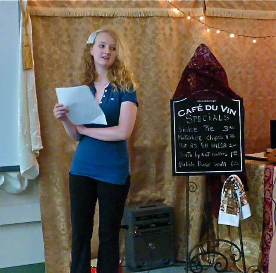 Eigth-grader Brianna Hurd collects her thoughts Tuesday before she recites an original poem for the Poetry Cafe at Ansonia Middle School. Patricia Villers/Register