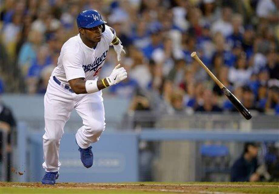 Los Angeles Dodgers' Yasiel Puig hits a single during the third inning of a baseball game against the Atlanta Braves, Saturday, June 8, 2013, in Los Angeles.  (AP Photo/Mark J. Terrill) Photo: AP / AP