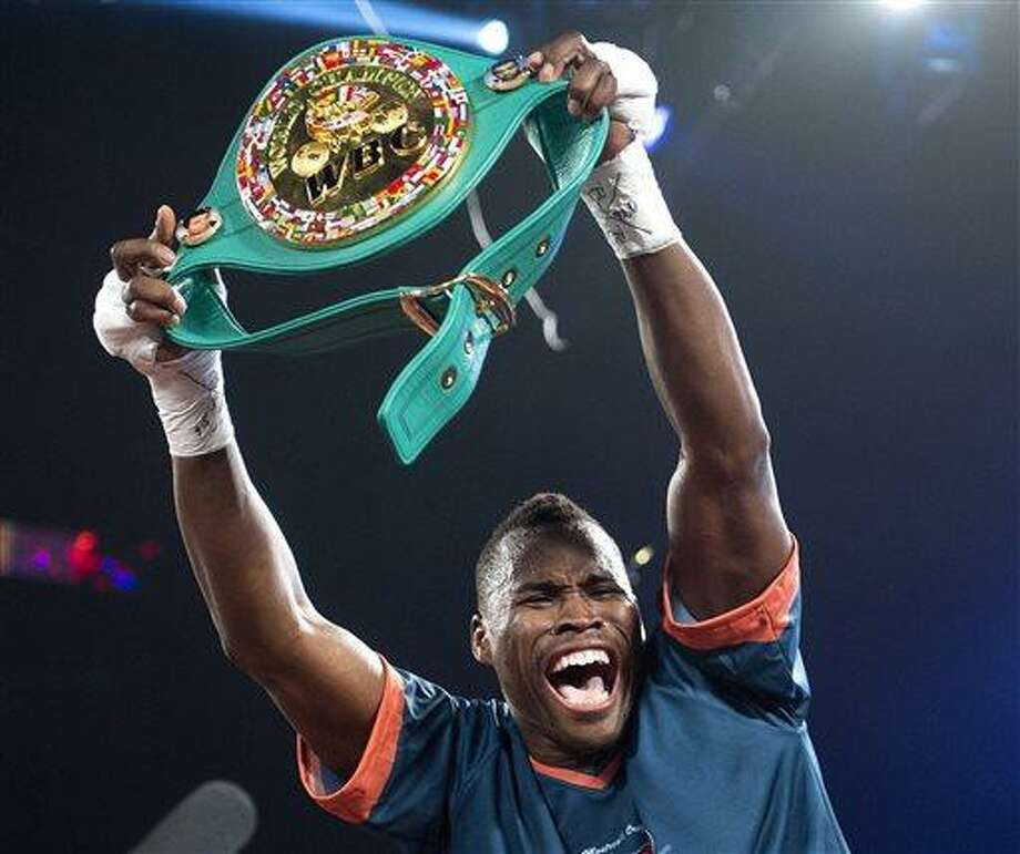 Adonis Stevenson from Canada celebrates after knocking Chad Dawson from the United States out in the first round of their WBC light-heavyweight championship bout in Montreal, Saturday, June 8, 2013. (AP Photo/The Canadian Press, Graham Hughes) Photo: AP / CP