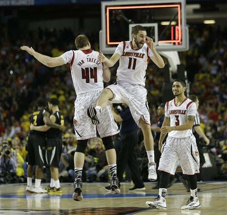 Louisville's Luke Hancock (11) Louisville's Peyton Siva (3) and Louisville's Stephan Van Treese (44) react after the second half of the NCAA Final Four tournament college basketball semifinal game against Wichita State Saturday, April 6, 2013, in Atlanta. Louisville won 72-68. (AP Photo/John Bazemore) Photo: ASSOCIATED PRESS / AP2013