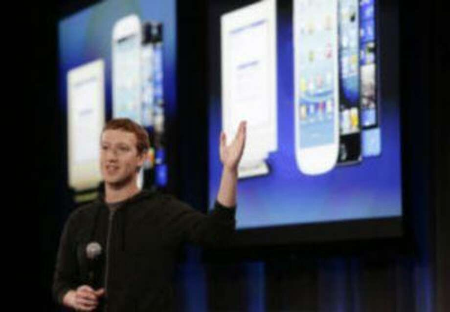 Mark Zuckerberg, Facebook CEO, describes a new Android smartphone at Facebook headquarters in Menlo Park, Calif. on Thursday, April 4, 2013. Photo: San Jose Mercury News / San Jose Mercury News