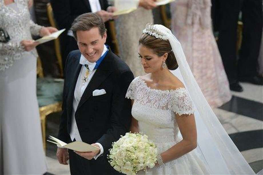 Princess Madeleine of Sweden and Christopher O'Neill during their wedding ceremony at the Royal Chapel in Stockholm, Saturday June 8, 2013. (AP Photo/Fredrik Sandberg) SWEDEN OUT Photo: AP / Scanpix Sweden