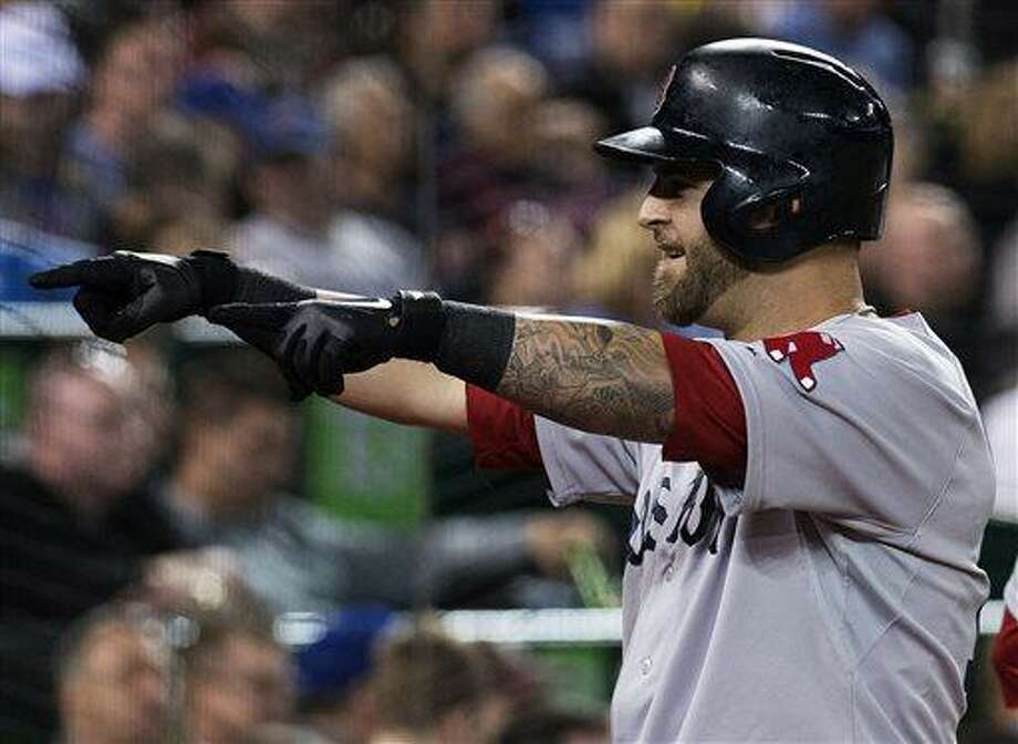 Boston Red Sox first baseman Mike Napoli celebrates his two-run home run with teammates in the dugout while playing against the Toronto Blue Jays during fifth-inning baseball game action in Toronto, Friday, April 5, 2013. (AP Photo/The Canadian Press, Nathan Denette) Photo: AP / The Canadian Press