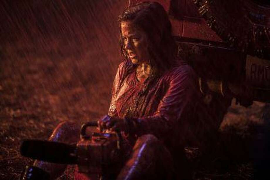 """Jane Levy plays a junkie whose drug intervention in a remote cabin doesn't go quite as planned, in """"Evil Dead."""" Photo: The Washington Post / WASHINGTON POST"""