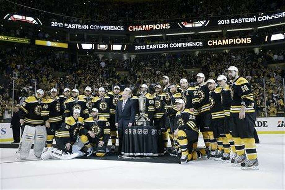The Boston Bruins pose with the trophy after beating the Pittsburgh Penguins 1-0 in Game 4 of the Eastern Conference finals of the NHL hockey Stanley Cup playoffs, in Boston on Friday, June 7, 2013. The Bruins advanced to the Stanley Cup finals. (AP Photo/Elise Amendola) Photo: AP / AP