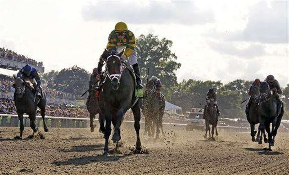 Palace Malice, center, with jockey Mike Smith, wins the 145th Belmont Stakes horse race at Belmont Park Saturday, June 8, 2013, in Elmont, N.Y. (AP Photo/Julio Cortez) Photo: AP / AP
