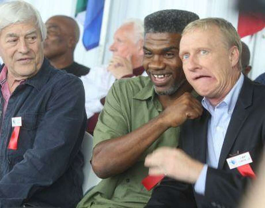 2013 Hall of Fame Inductee Jimmy Lennon Jr. (right) makes a face as he poses with Julian Jackson before the opening ceremony at the International Boxing Hall of Fame in Canastota, N.Y., on Thursday.