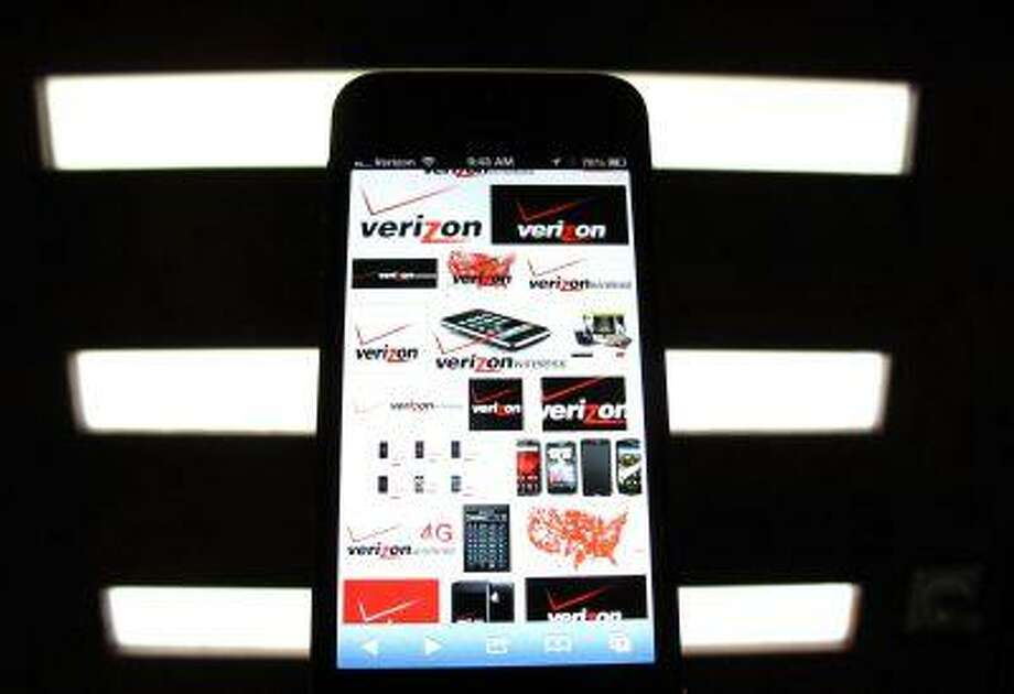 A photo illustration shows the Verizon wireless logos on a mobile phone screen in Encinitas, Calif. June 6, 2013. The Obama administration on June 6, 2013 acknowledged that it is collecting a massive amount of telephone records from at least one carrier, reopening the debate over privacy even as it defended the practice as necessary to protect Americans against attack. Photo: REUTERS / X00030