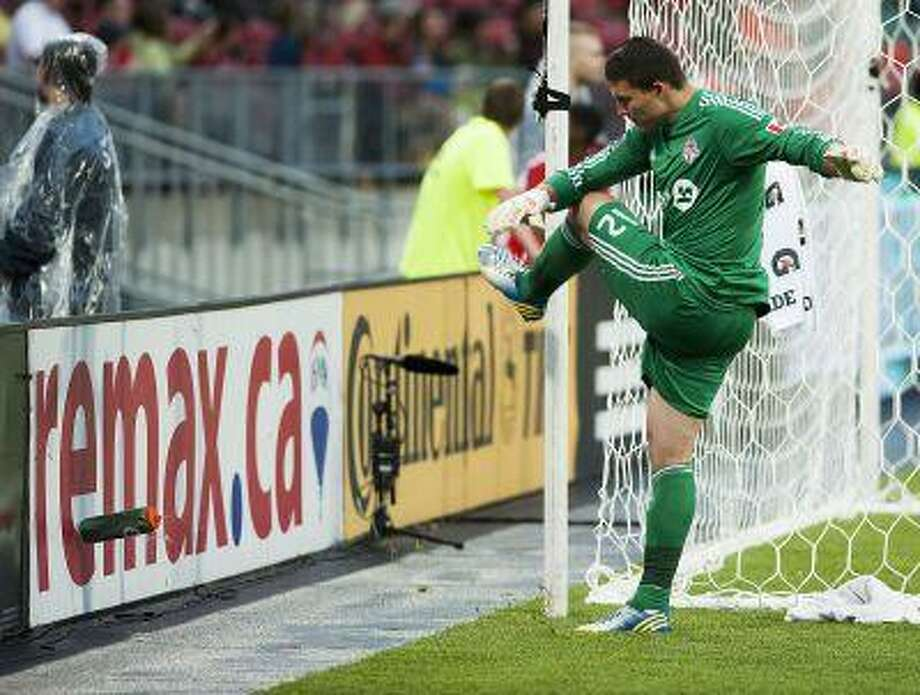 Toronto FC goalie Joseph Bendik kicks a water bottle after letting in a goal by the Philadelphia Union to tie the score during the second half of an MLS soccer game in Toronto on Saturday, June 1, 2013. Photo: AP / The Canadian Press