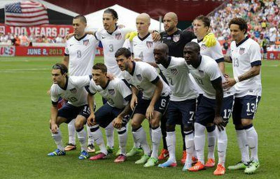 The U.S. team poses for a team photo before an international friendly soccer match against Germany at RFK Stadium Sunday, June 2, 2013, in Washington. Photo: AP / AP