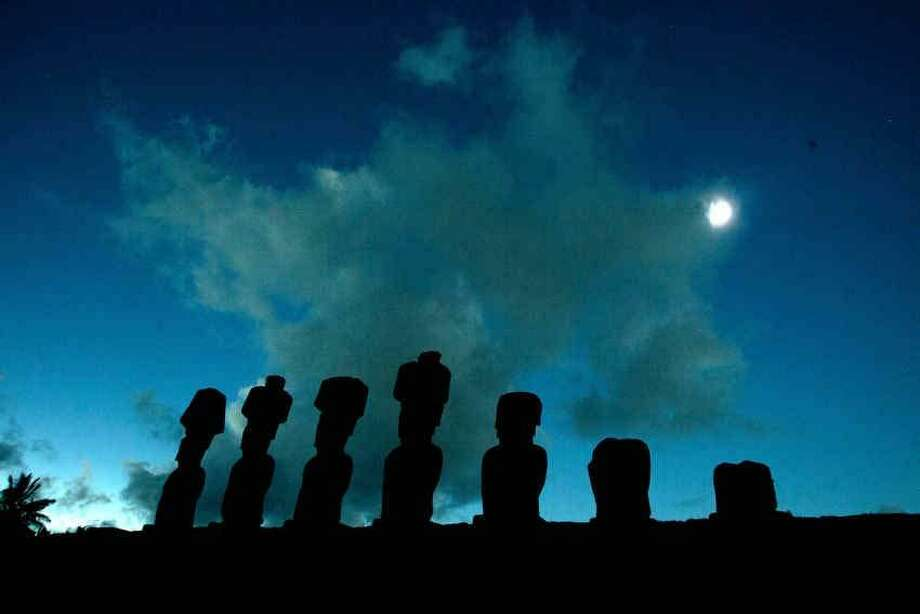Stone statues known as Moais are pictured during the total solar eclipse in Easter Island, Chile, some 4,000 km (2,480 miles) west of the Chilean coast, Sunday, July 11, 2010. (AP Photo/Patricio Munoz) Photo: ASSOCIATED PRESS / AP2010