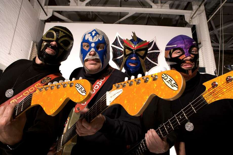 Contributed photo: Los Straitjackets, believe it or not, started as a band in Nashville back in 1988. Photo: Jim Graham / © 2004 Jim Graham All Rights Reserved