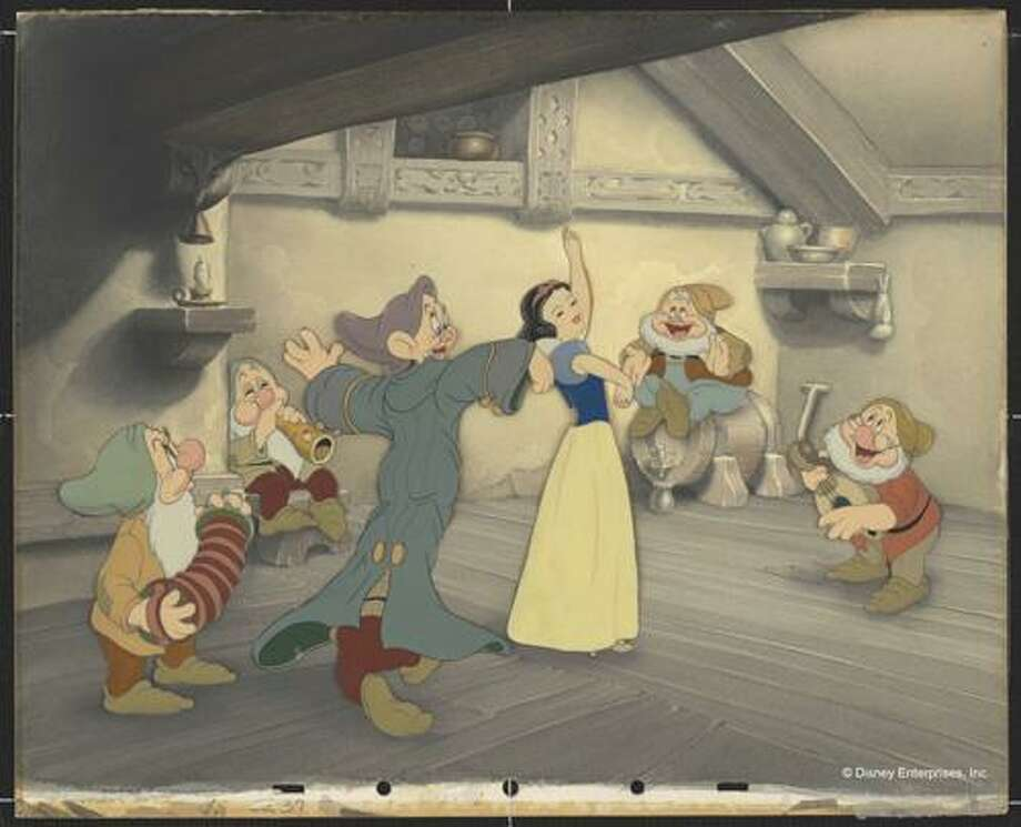 Courtesy Walt Disney Animation Research Library; &Copy;Disney.ÔSnow White Dancing with Dopey and Sneezy. Doc, Happy, Bashful, Sleepy Playing Music.Õ Disney Studio Artist Reproduction cel setup; ink and acrylic on cellulose acetate / Copyright (C) reserved