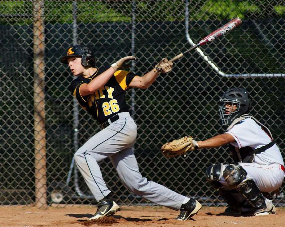 "Amity's Sebastian DiMauro cranks an RBI triple during the third inning against Greenwich in the Class LL quarterfinals. Photo-Peter Casolino/Register  <a href=""mailto:pcasolino@newhavenregister.com"">pcasolino@newhavenregister.com</a>"
