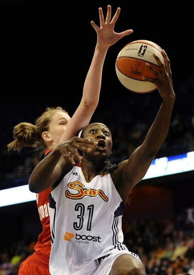 Connecticut's Tina Charles goes up for a basket as she is fouled by Washington's Emma Meesseman during the second half of a WNBA basketball game in Uncasville Friday. Washington won 66-62. (AP Photo/Jessica Hill) Photo: AP / FR125654 AP