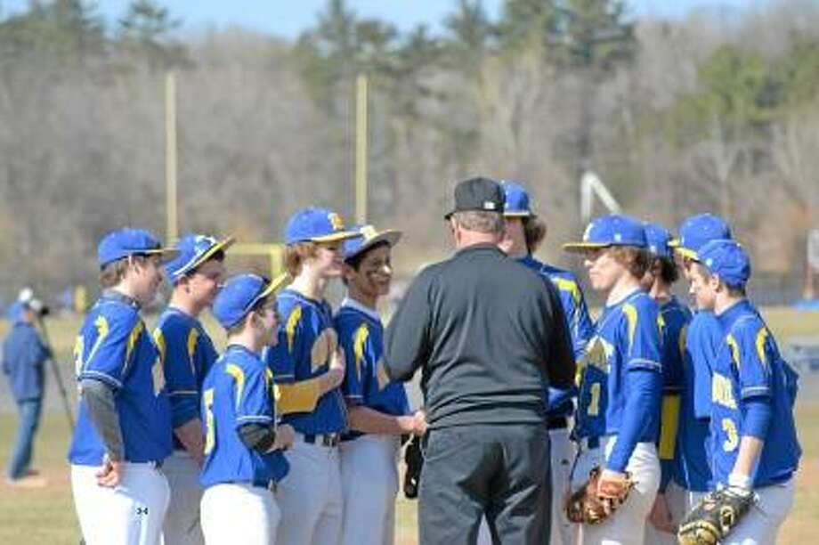 Pete Paguaga/Register Citizen  Former Housatonic graduate and Pittsburgh Pirates pitcher, John Lamb talks with the Housatonic team before they take the field.