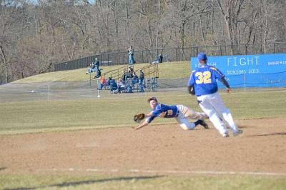 Pete Paguaga/Register Citizen  Housatonic shortstop, Zach Larson dives for a ball, but comes up short.