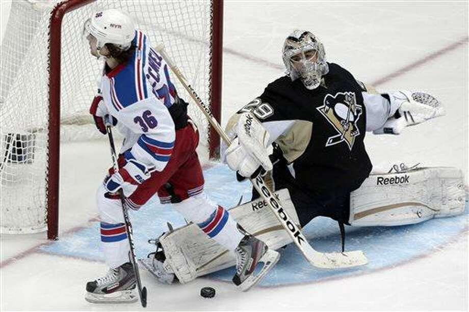 Pittsburgh Penguins goalie Marc-Andre Fleury (29) stops a shot by New York Rangers right wing Mats Zuccarello (36) during the shootout in an NHL hockey game in Pittsburgh Friday, April 5, 2013. The Penguins won 2-1. (AP Photo/Gene J. Puskar) Photo: ASSOCIATED PRESS / AP2013