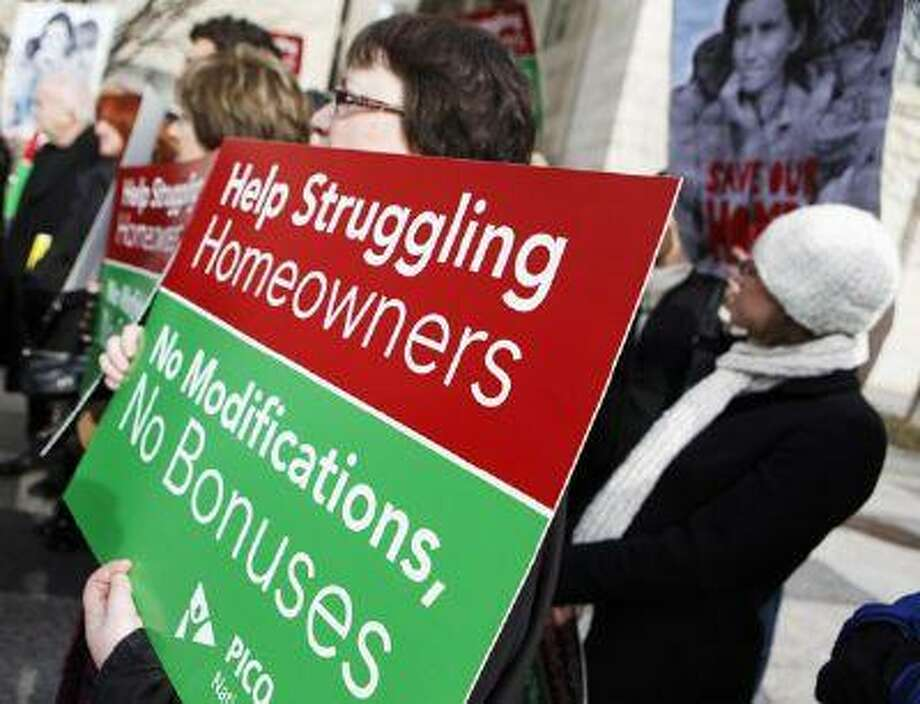 Groups of homeowners attend a news conference on home foreclosures near the Treasury Department in Washington in 2009. (Haraz N. Ghanbari/The Associated Press)